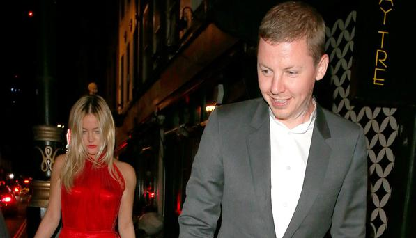 Professor Green and Laura Whitmore leaving Groucho in London. Picture: Splash News