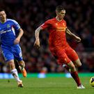 LIVERPOOL, ENGLAND - JANUARY 01: Daniel Agger of Liverpool moves away from Robert Koren of Hull City during the Barclays Premier League match between Liverpool and Hull City at Anfield on January 1, 2014 in Liverpool, England. (Photo by Clive Brunskill/Getty Images)