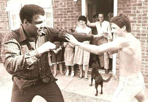 Paddy Monaghan and Muhammad Ali stage a mock fight in the Irishman's home in Oxfordshire, England. Photo: PA