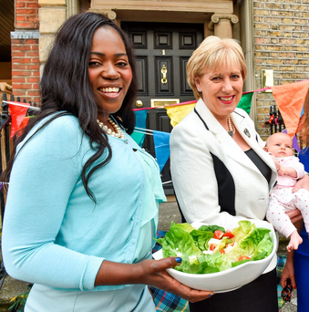 Street Feast host Ellie Kisyome with Arts and Heritage Minister Heather Humphreys holding Poppy Ó Breacháin (2 months) at the launch of this Sunday's festival. Photo: Ruth Medjber