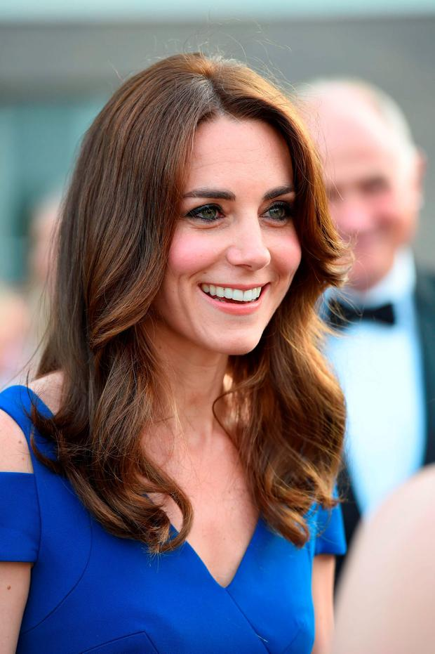Kate Middleton in royal blue. Photo: Eddie Mulholland/The Telegraph/PA Wire