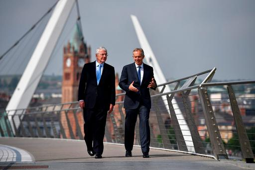 Former British prime ministers John Major and Tony Blair walk across the Peace Bridge in Derry before a news conference on the Brexit referendum. Photo: Reuters