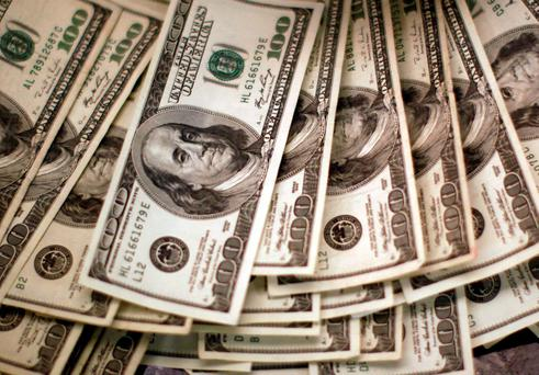 The dollar held earlier gains versus a basket of currencies after the data, while prices for US Treasuries rose. Photo: Reuters