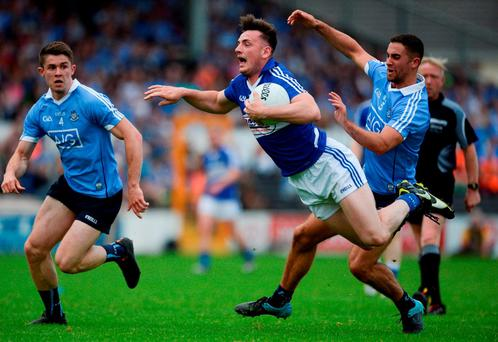 Gary Walsh of Laois in action against James McCarthy of Dublin in the Leinster GAA Football Senior Championship Quarter-Final match between Laois and Dublin in Nowlan Park, Kilkenny. Picture credit: Dáire Brennan / SPORTSFILE