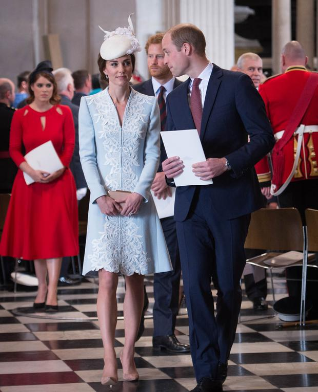 Britain's Catherine, Duchess of Cambridge, (L), Britain's Prince William, Duke of Cambridge, (R) and Britain's Prince Harry (C) leave at the end of a national service of thanksgiving for the 90th birthday of Britain's Queen Elizabeth II at St Paul's Cathedral in London / AFP / POOL / Stefan Rousseau