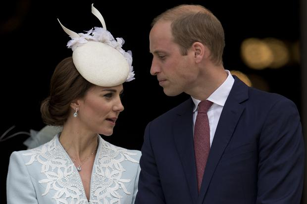 Britain's Catherine, Duchess of Cambridge (L) and Britain's Prince William, Duke of Cambridge (R) leave after attending a national service of thanksgiving for the 90th birthday of Britain's Queen Elizabeth II at St Paul's Cathedral in London on June 10, 2016 / AFP / JUSTIN TALLIS