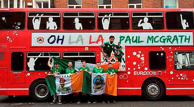 (from the left) Andy Bennett from Malahide, Brian Cullen, Aidan McGuinness, Kevin Johnson and Eoin O'Donoghue, all from Skerries, stand outside an old double-decker bus that they are taking on their Euro 2016 adventure