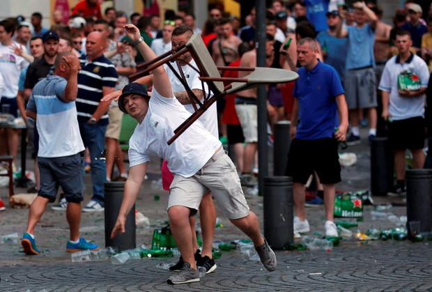 An England fan hurls a chair ahead of England's EURO 2016 match in Marseille, France, June 10, 2016. REUTERS/Jean-Paul Pelissier