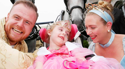 Princess Evie Lawlor (6) from Killester with Prince Charming and Cinderella. Photo: Sam Boal