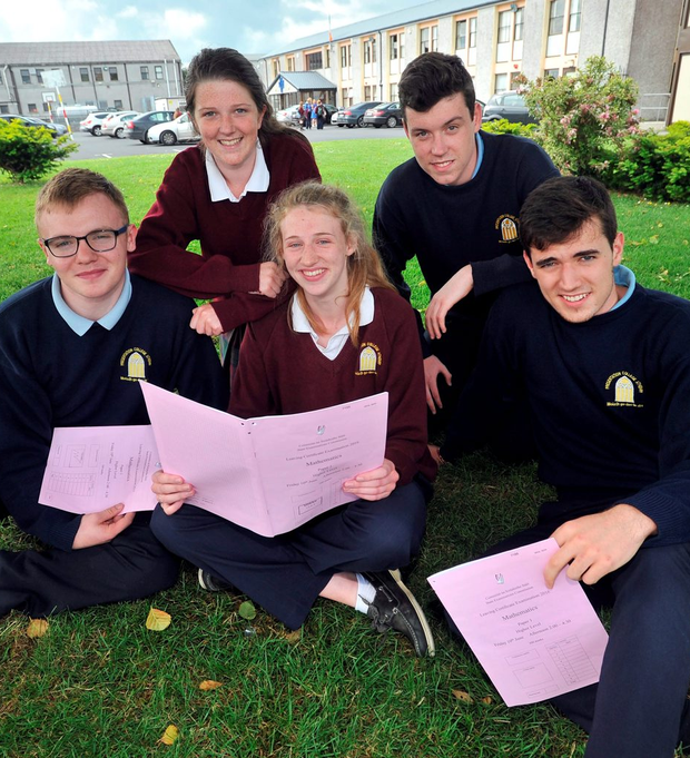 Evan Quirke, Lisa Doran, Luke Heneghan, in front, and Laura Gilligan and Sean Fogarty, at back, go over the Maths paper at Presentation College, Athenry. Photo: Ray Ryan