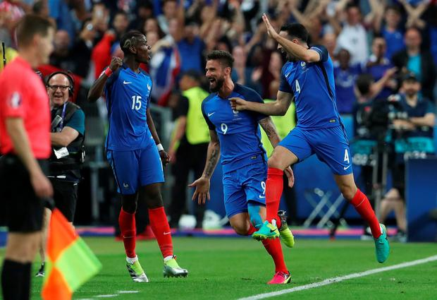 France's Olivier Giroud celebrates with team mates after scoring their first goal