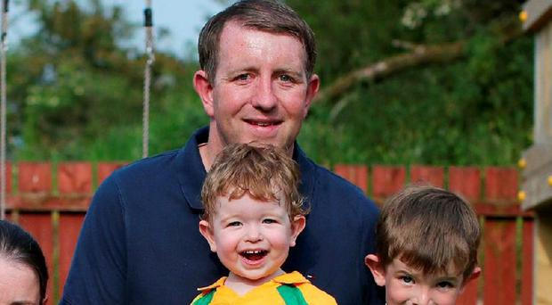 Ronan Gallagher at home with sons Shay (wearing the Donegal colours) and Joe (in the Fermanagh jersey)