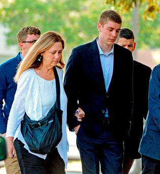 Brock Turner, right, makes his way into the Santa Clara Superior Courthouse in Palo Alto, Califiornia Photo: Dan Honda/AP