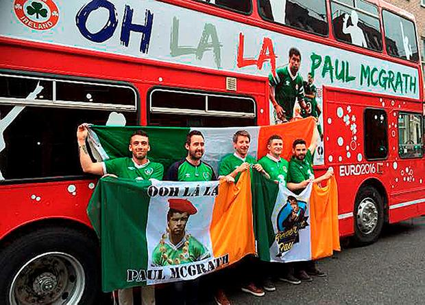 Andy Bennett, Brian Cullen, Aidan McGuinness, Kevin Johnson and Eoin O'Donoghue, all from Dublin, with an old double-decker bus that they revamped for their Euro 2016 adventure. Photo: PA