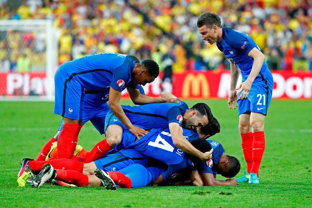 France's Dimitri Payet celebrates with team mates after scoring their second goal