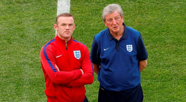 England manager Roy Hodgson and Wayne Rooney walk on the pitch ahead of their match against Russia in Marseille Picture: Reuters