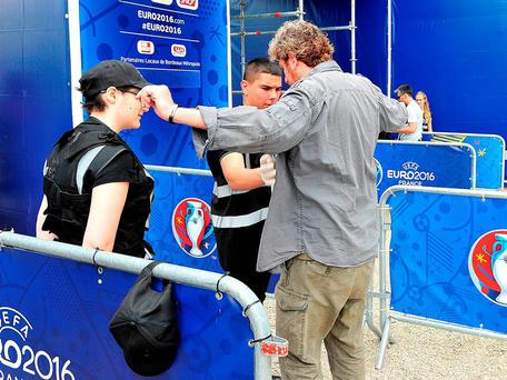 Security officers check a supporter as he arrives at the fan zone in Bordeaux after it opened yesterday. Photo: Getty.