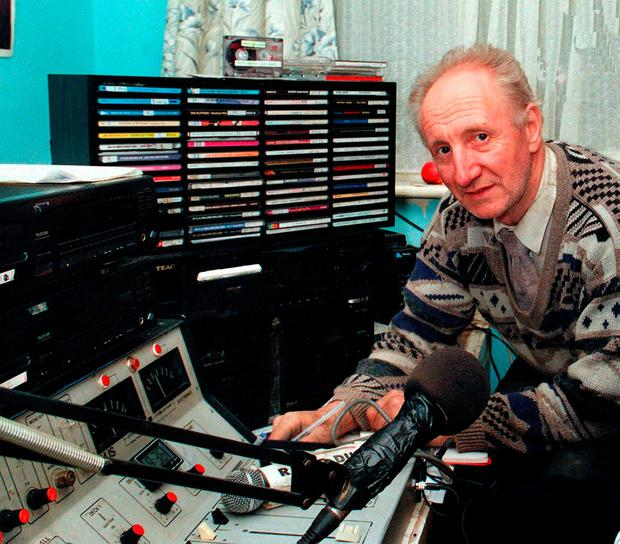 Pirate radio station DJ Eamon Cooke in his studio