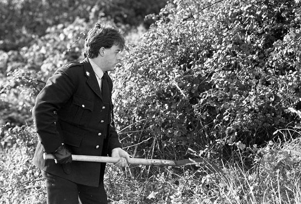 Gardai search the area around the Dodder between Templeogue and Tallaght in their efforts to find Philip in 1986