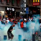 A tear gas canister explodes next to a football fan as England fans clash with police in Marseille on June 10, 2016 in Marseille, France. Football fans from around Europe have descended on France for the UEFA Euro 2016 football tournament. (Photo by Carl Court/Getty Images)