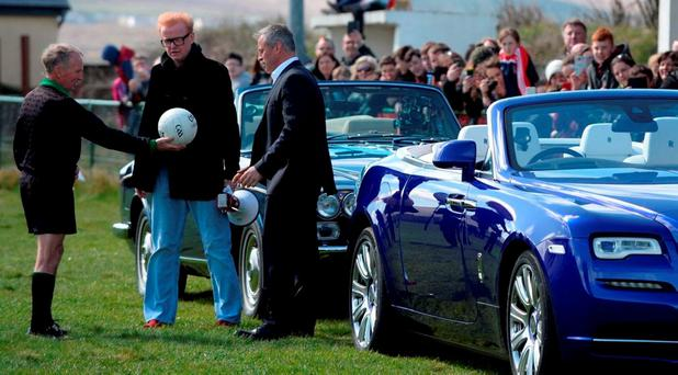 Chris Evans and Matt Le Blanc with their 1976 and 2016 Rolls Royce cars and local referee Richie Williams pictured filming an episode of Top Gear at Gallarus GAA club in West Kerry Photo: Don MacMonagle