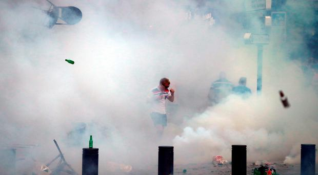 An England fan is surrounded by tear gas during a clash in Marseille (Photo by Carl Court/Getty Images)