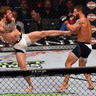 LAS VEGAS, NV - JULY 11: (L-R) Conor McGregor kicks Chad Mendes during the UFC 189 event inside MGM Grand Garden Arena on July 11, 2015 in Las Vegas, Nevada. (Photo by Jeff Bottari/Zuffa LLC/Zuffa LLC via Getty Images)