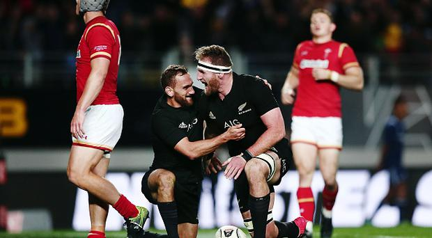 AUCKLAND, NEW ZEALAND - JUNE 11: Kieran Read of New Zealand celebrates after scoring a try with teammate Aaron Cruden during the International Test match between the New Zealand All Blacks and Wales at Eden Park on June 11, 2016 in Auckland, New Zealand. (Photo by Anthony Au-Yeung/Getty Images)