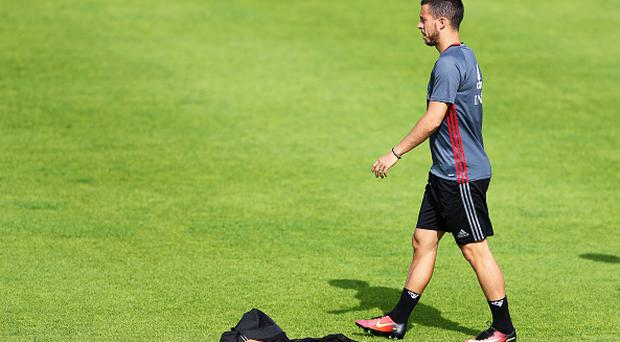 BORDEAUX, FRANCE - JUNE 10: Eden Hazard of Belgium warms up during the Belgium Training Session held at Chateau du Haillan on June 10, 2016 in Bordeaux, France. (Photo by Dean Mouhtaropoulos/Getty Images)