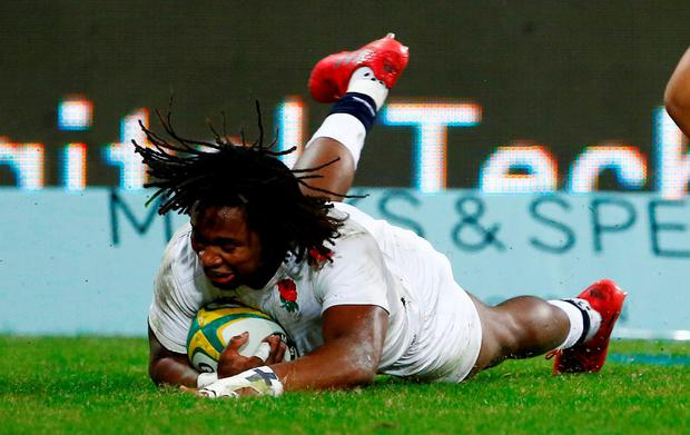 England's winger Marland Yarde scores a try in the second half of the match