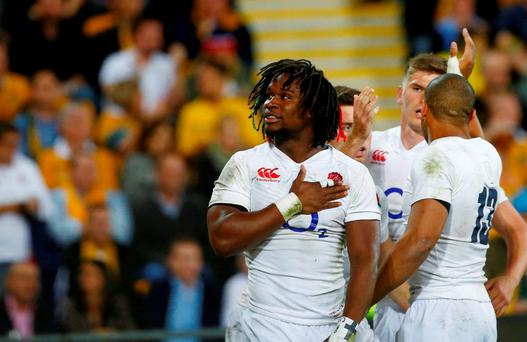 England's winger Marland Yarde reacts to the crowd after scoring a try against Australia
