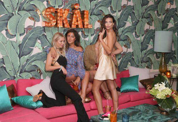 Actress/Model Emily Ratajkowski's (R) poses for photos with friends during her 25th birthday celebration held at the private residence of Absolut Elyx CEO Jonas Tahlin on June 10, 2016 in Los Angeles, California. (Photo by Rachel Murray/Getty Images for Absolut Elyx)