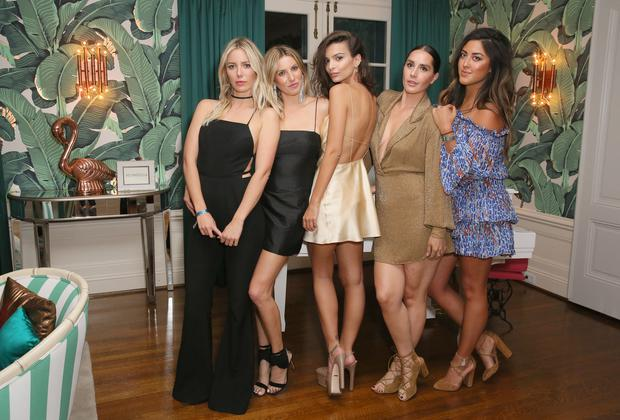 Actress/Model Emily Ratajkowski's (C) poses for photos with friends during her 25th birthday celebration held at the private residence of Absolut Elyx CEO Jonas Tahlin on June 10, 2016 in Los Angeles, California. (Photo by Rachel Murray/Getty Images for Absolut Elyx)