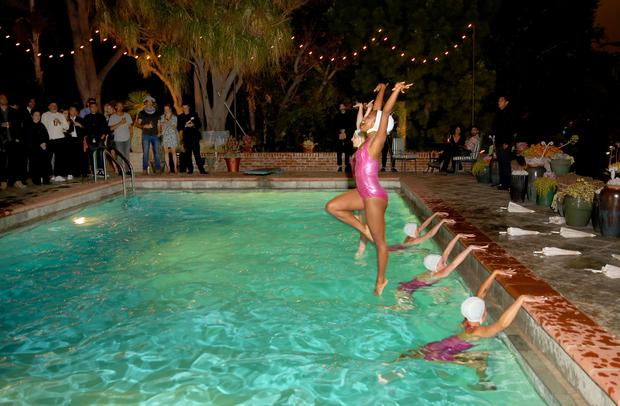 Synchronised Swimmers perform for guests during Emily Ratajkowski's 25th Birthday celebration at the private residence of Absolut Elyx CEO Jonas Tahlin on June 10, 2016 in Los Angeles, California. (Photo by Rachel Murray/Getty Images for Absolut Elyx)
