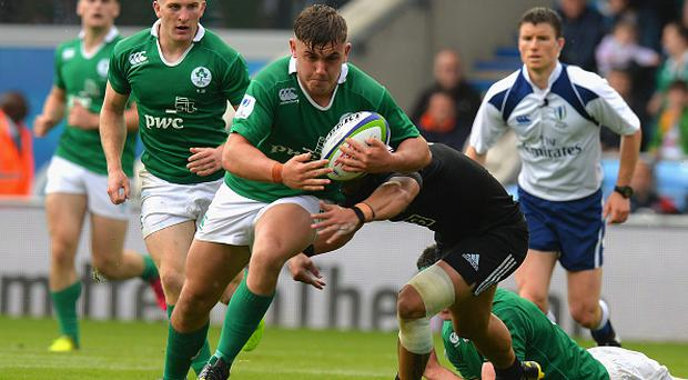 MANCHESTER, ENGLAND - JUNE 11: Sam Noc of New Zealand tackles Adam McBurney of Ireland during the World Rugby U20 Championship match between New Zealand and Ireland at The Academy Stadium on June 11, 2016 in Manchester, England. (Photo by Tony Marshall/Getty Images)