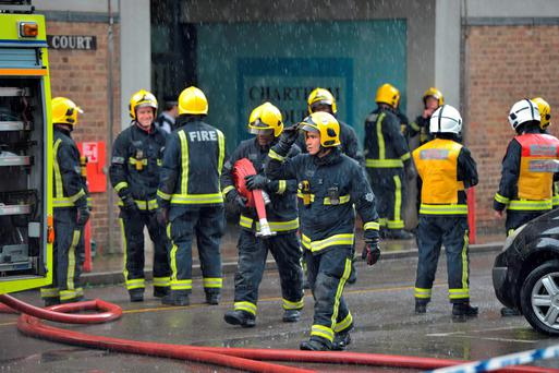 Police and Firefighters at a block of flats in Brixton, London where a fire broke out and 50 people had to be evacuated