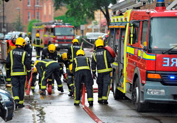 Firefighters at a block of flats in Brixton, London where a fire broke out and 50 people had to be evacuated.