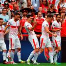 Switzerland's Fabian Schaer, center, celebrates after scoring the opening goal