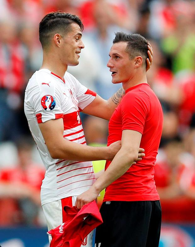 Switzerland's Granit Xhaka with his brother Albania's Taulant Xhaka at the end of the game