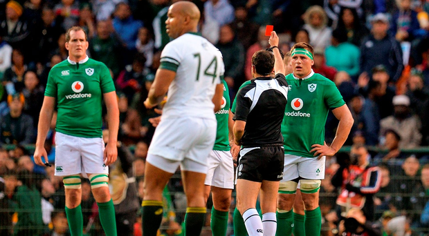 CJ Stander, right, of Ireland is shown a straight red card by referee Mathieu Raynal