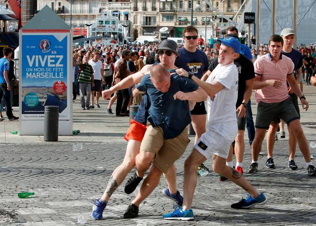 Rival supporters clash at the old port of Marseille before the game