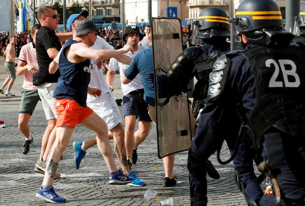 Rival supporters clash at the old port of Marseille