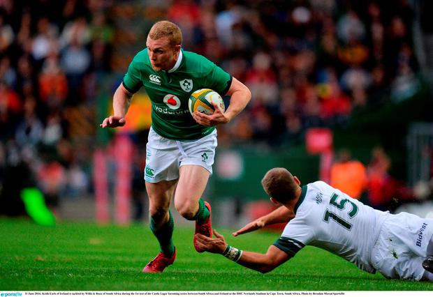Keith Earls of Ireland is tackled by Willie le Roux of South Africa