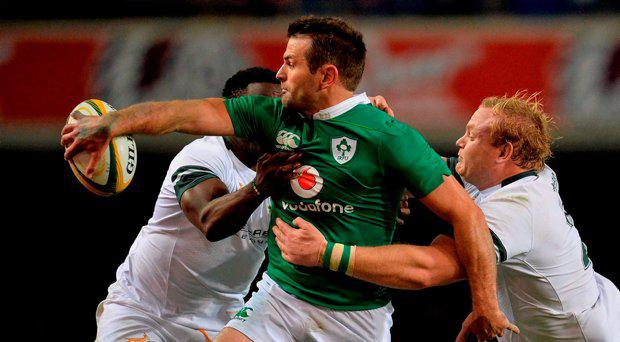 11 June 2016; Jared Payne of Ireland offloads a pass while being tackled by Lwazi Mvovo, left, and Adriaan Strauss of South Africa during the 1st test of the Castle Lager Incoming series between South Africa and Ireland at the DHL Newlands Stadium in Cape Town, South Africa
