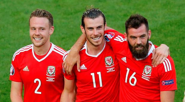 Wales' Chris Gunter, Gareth Bale and Joe Ledley celebrate after the match