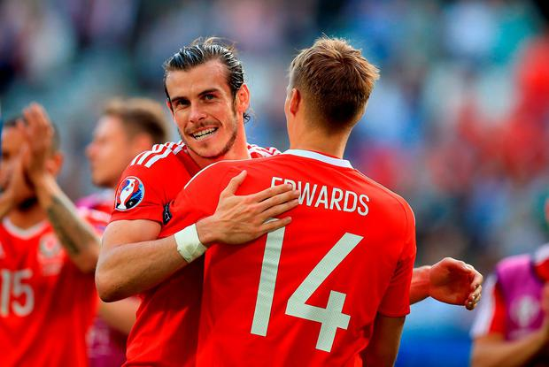 Wales' Gareth Bale (left) celebrates after the final whistle with David Edwards