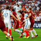 England's Chris Smalling heads at goal