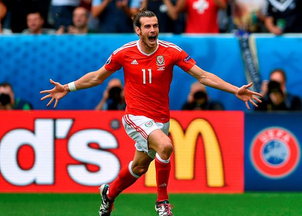 Wales' Gareth Bale celebrates scoring the opening goal. Photo: Joe Giddens/PA Wire.
