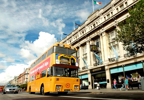 A restored former Dublin Bus passes Clerys on O'Connell Street Picture: Gerry Mooney
