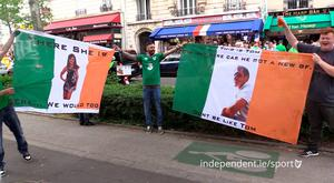 Friends Darren McNamara, Daniel Hegarty and Aaron Ryan with their flags in Montmartre, Paris